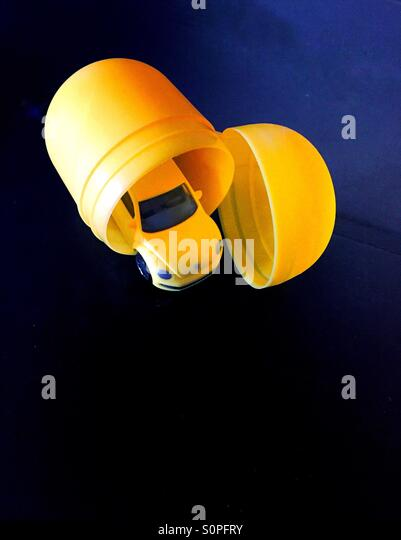 Surprise car toy in egg. Volkswagen car. - Stock Image