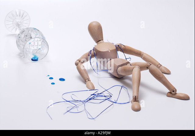 Wooden man post party suffering from hangover - Stock Image