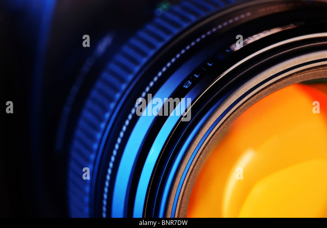 Close-up of a camera-lens attached to a modern digital camera - Stock Image
