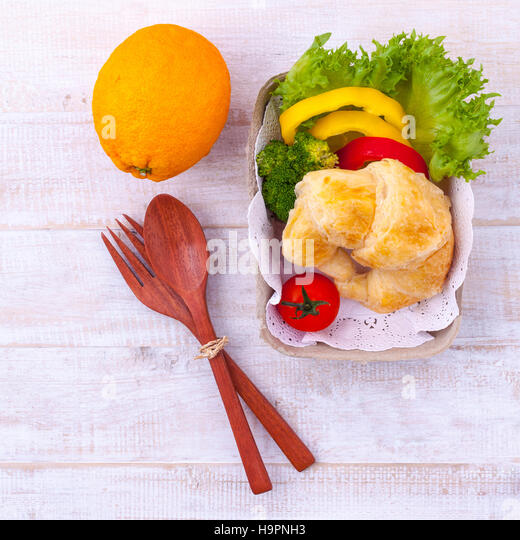Clean food breakfast croissant and salad on wooden table. - Stock-Bilder