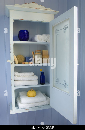 Vintage Bathroom Cabinet With Frosted Glass Door And Toiletries, Including  Soap And Towels.