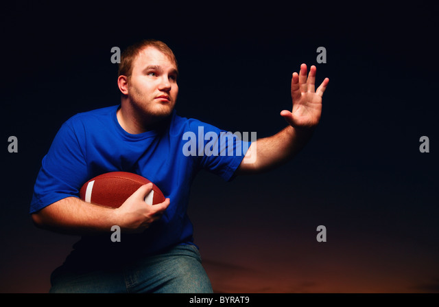 a young man playing football; wilmar, minnesota, united states of america - Stock Image