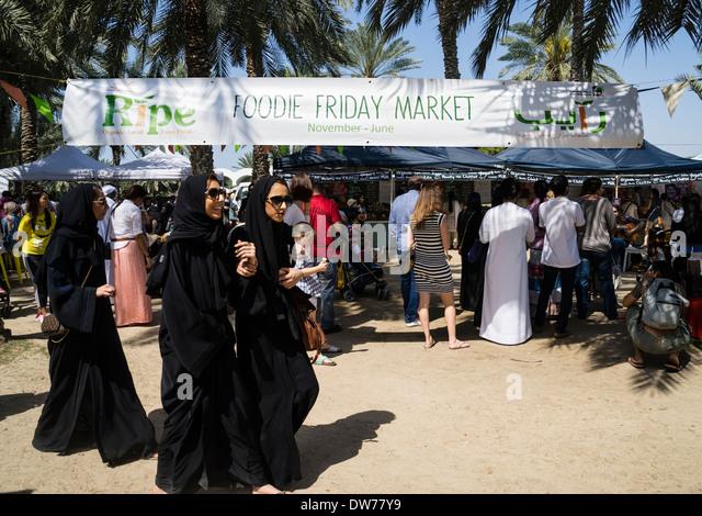 Busy food market held on holiday Fridays in Al Safa Park in Dubai United Arab Emirates - Stock Image