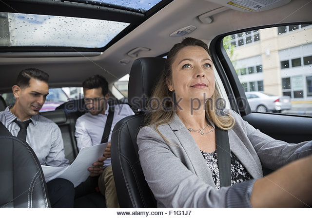 Business people carpooling in car - Stock Image
