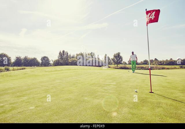 Golfer playing golf, near 14th hole, Korschenbroich, Dusseldorf, Germany - Stock Image
