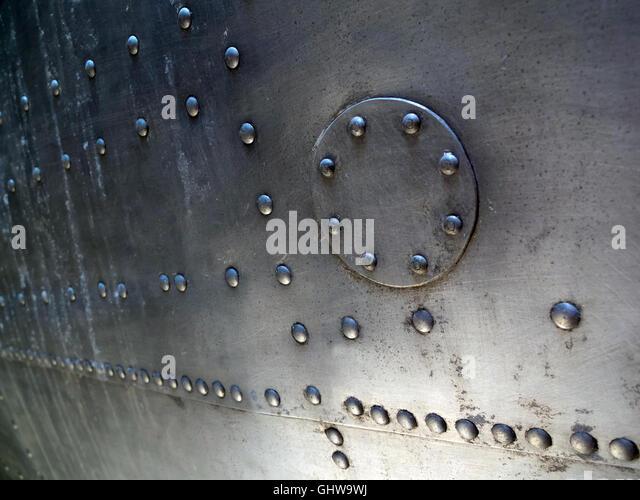 rivets on vintage aircraft fuselage - Stock Image