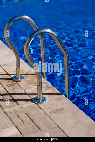 Swimming pool and ladder railings - Stock Image