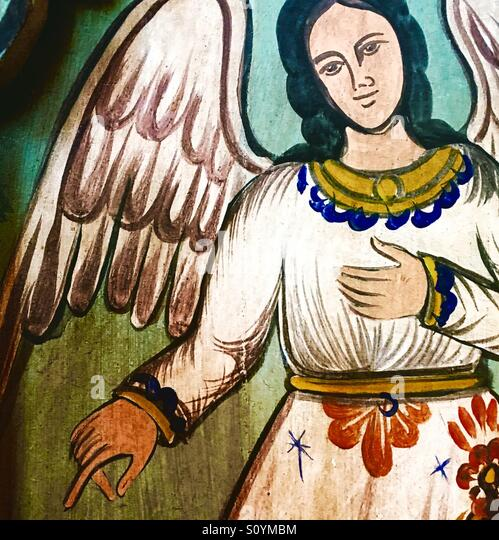 Painted angel on wood - Stock Image