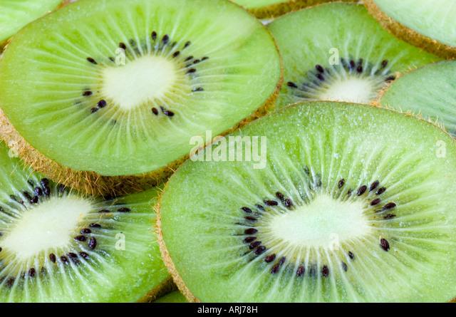 Fresh organic Kiwi Fruit Slices arranged showing the pips & structure - Stock Image