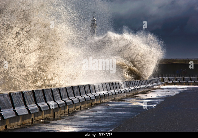 Waves crushing against barrier, Sunderland, Tyne and Wear, England - Stock Image