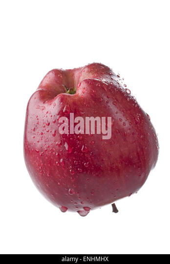Red apple with water drops on white background. - Stock Image