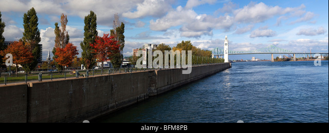 Clock tower and Jacques Cartier Bridge, Montreal, Canada - Stock Image