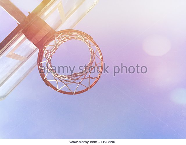 Low Angle View Of Basketball Hoop Against Blue Sky - Stock Image