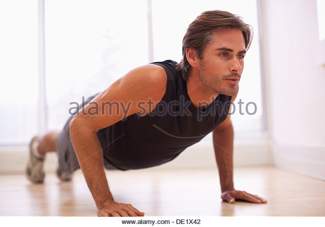 Man doing push-ups - Stock Image