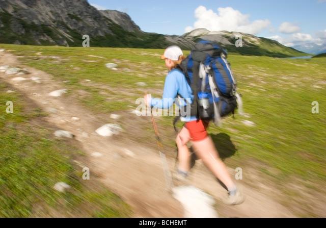Female backpacker hiking on the Kesugi Ridge Trail Denali State Park Interior Alaska summer - Stock Image