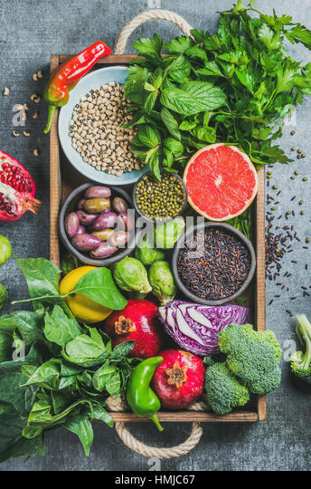 Fresh vegetables and fruits, seeds, cereals, beans, spices, superfoods, herbs - Stock Image