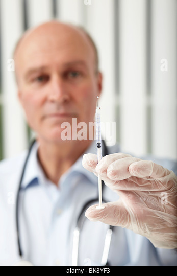 Doctor with a syringe - Stock Image