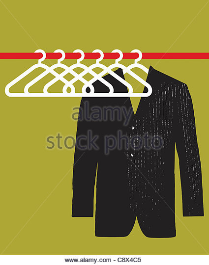 Suit jacket hanging in empty closet - Stock Image