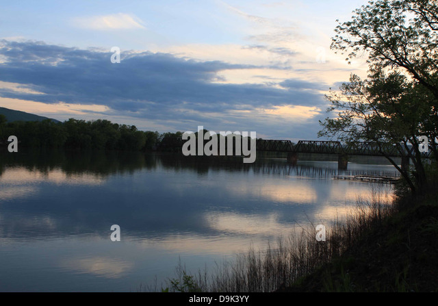 bridge iron over water river Susquehanna, Williamsport, PA, Pennsylvania, Lycoming County, USA, trees, mountain, - Stock Image