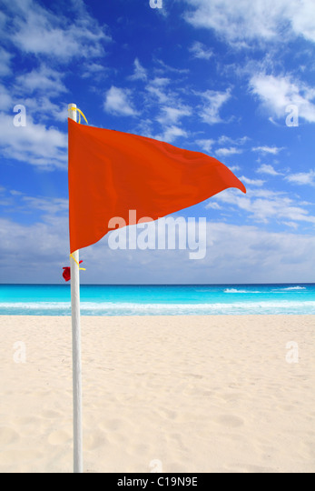 Beach red flag bad weather wind advice dangerous Caribbean turquoise sea - Stock Image
