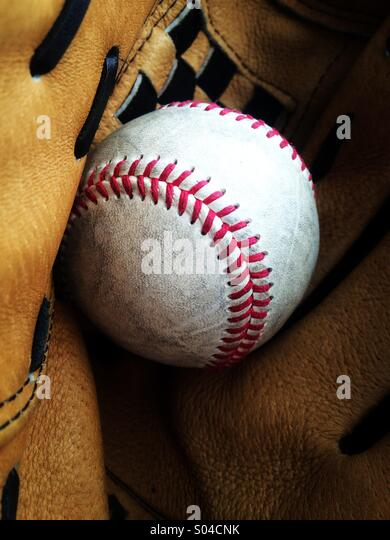 Baseball in a glove - Stock Image