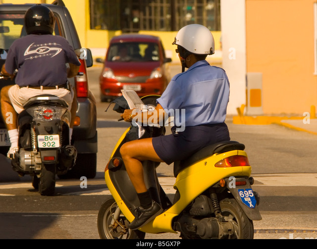 bermuda mopeds traffic transportation cycles police woman wears helmet on yellow bike Saint George - Stock Image