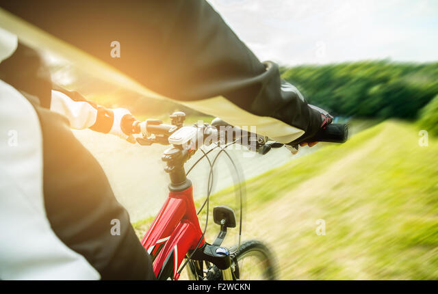 Mountain biking down hill descending fast. View from bikers eyes. - Stock-Bilder