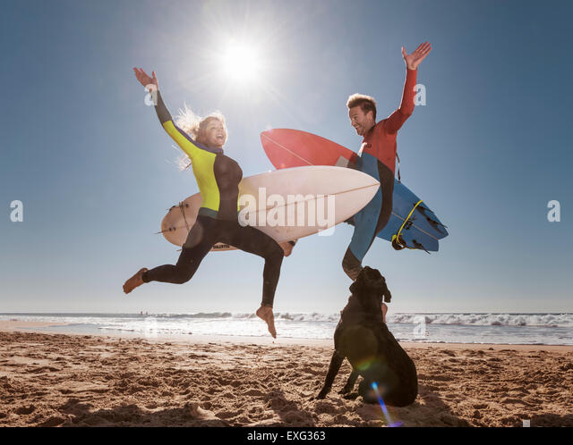 Couple of crazy surfers. El Palmar, Tarifa, Cadiz, Costa de la Luz, Andalusia, Southern Spain. - Stock Image