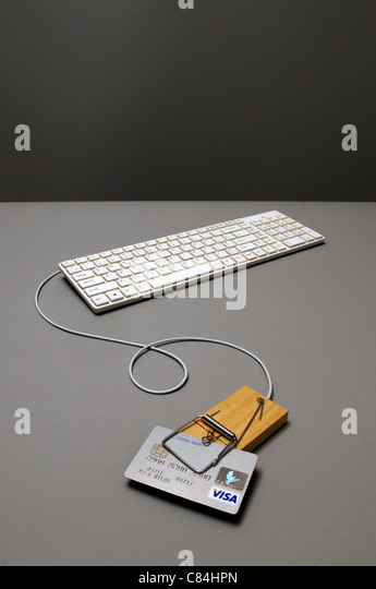Caredit card in mousetrap connected to keyboard - Stock Image