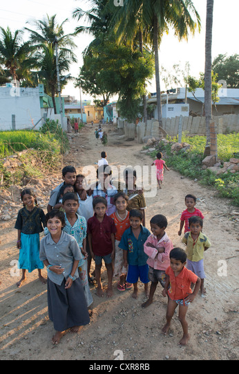 Happy young rural Indian village children in their village. Andhra Pradesh, India - Stock Image