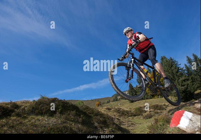 Mountainbiker on Gaisberg mountain, Rettenbach, Tyrol, Austria, Europe - Stock Image