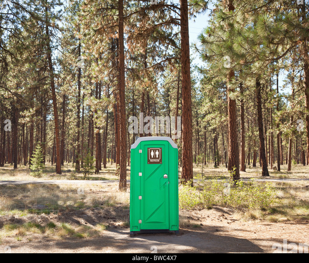 Portable toilet on edge of forest - Stock Image