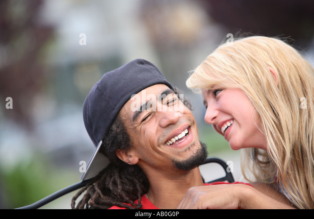 Young couple smiling together - Stock-Bilder