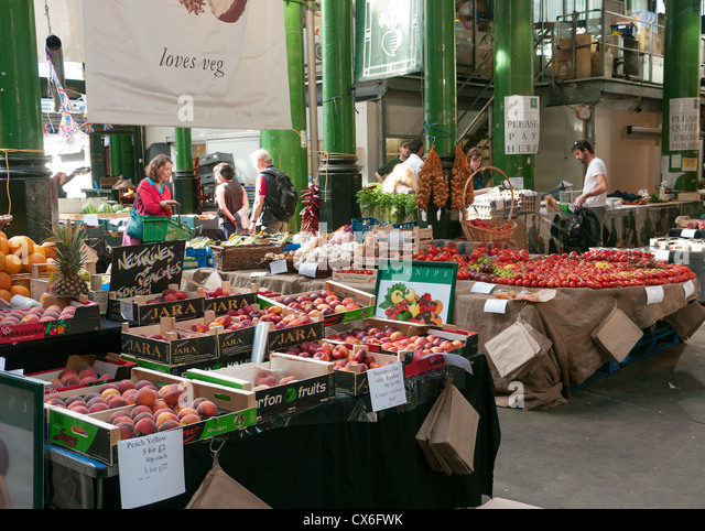 Stall selling all kinds of fruit and vegetables in Borough Market, London, UK - Stock Image