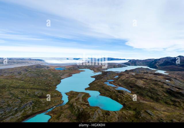 Turquoise glacial lakes on a highland tundra plateau. - Stock Image