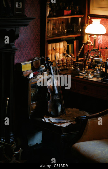 Violin by desk - Stock Image