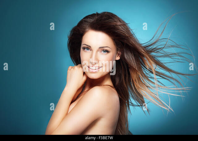 Woman over blue background - Stock Image