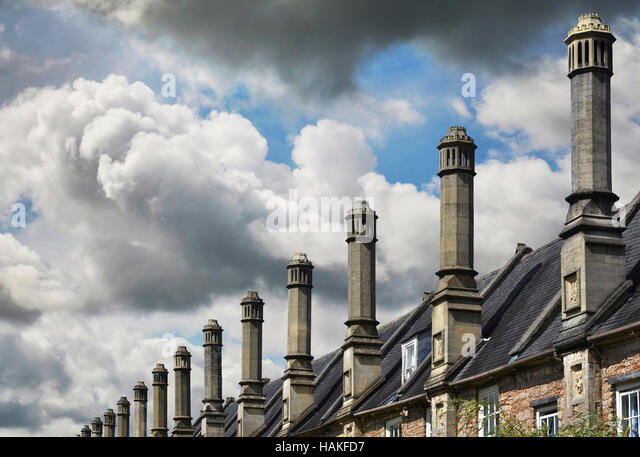 Row of Chimneys on Roofs of Houses, Wells, England, UK - Stock Image