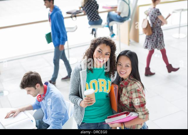 University students smiling - Stock Image