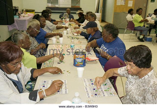 Miami Florida Charles Hadley Park community senior center activities Black Black woman women bingo game chance recreation - Stock Image