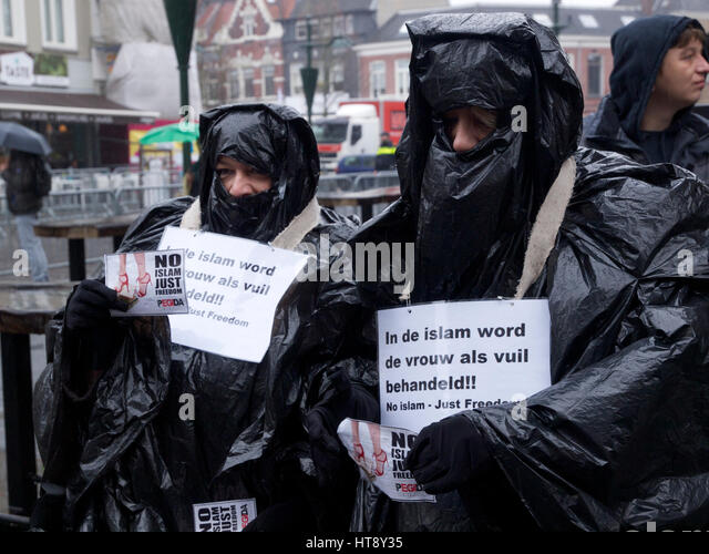 Women that support Pegida, against Islam, wearing a fake Burqa made from bin liners. Breda, the Netherlands. Islam - Stock Image