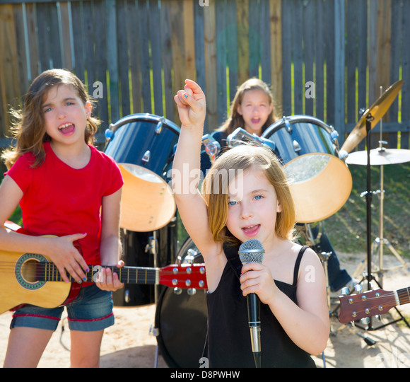 singer girl singing playing live band in backyard concert with friends