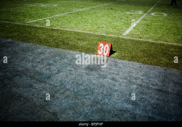 30 yard line marker on a football field - Stock Image