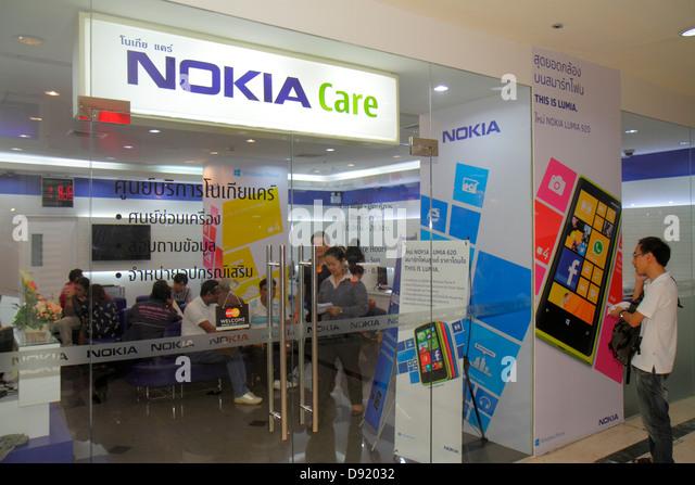 Thailand Bangkok Pathum Wan Rama 1 Road MBK Center centre complex mall shopping Nokia Care smartphone service Lumia - Stock Image