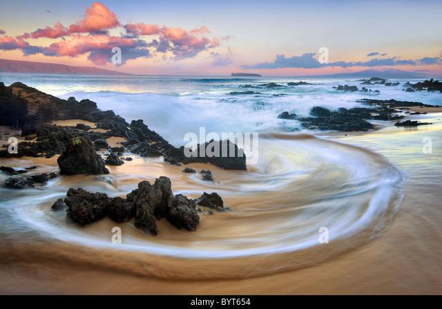 Wave pattern and sunrise clouds. Maui, Hawaii - Stock-Bilder