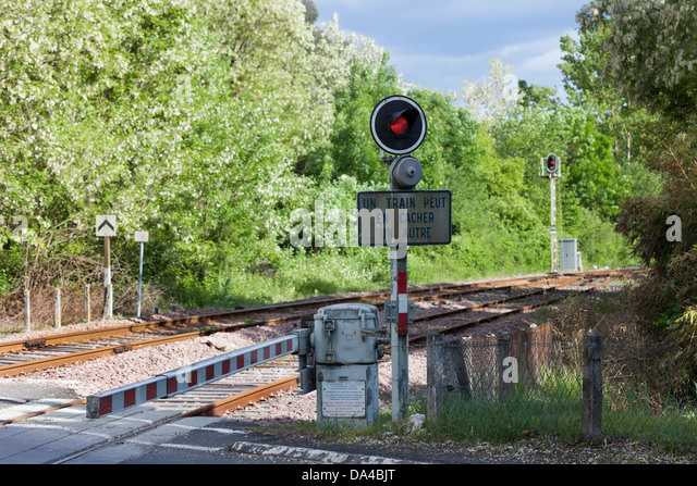 Red Light at a Level Crossing in the Village of Les Eyzies de Tayac Dordogne France. - Stock Image