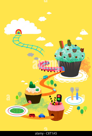 Train Travelling Through Cup Cake - Stock Image