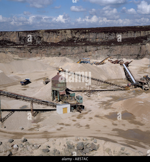 Secondary crushing plant and conveyor belts at Buckton Vale sandstone quarry, Stalybridge, Greater Manchester, England, - Stock Image