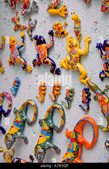 Cozumel Mexico San Miguel town bright colors red yellow ceramics hanging on wall shopping and souvenirs - Stock Image