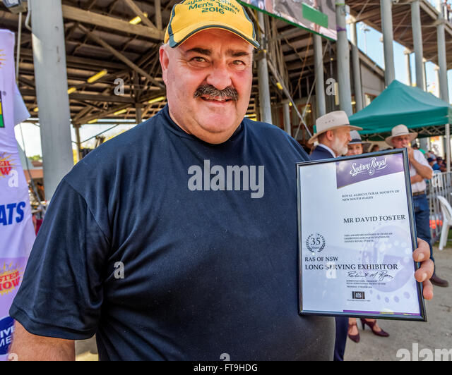 Sydney, Australia. 26th Mar, 2016. World champion wood-chopper David Foster OAM receives an award after 35 years - Stock Image